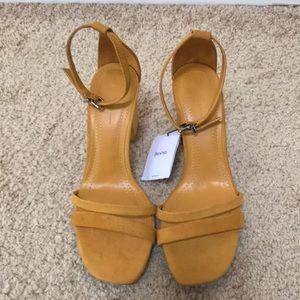 Bershka size 6.5, mustard faux suede heels .